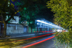 Night and blurry lights of cars on the streets Stock Photos