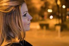 Night bokeh. Girl in night city lights. Young woman on the night city street. Night bokeh. Girl in night city lights stock photo