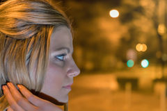 Night bokeh. Girl in night city lights. Young woman on the night city street. Night bokeh. Girl in night city lights royalty free stock image