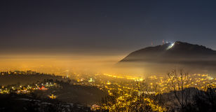 Night in Brasov. Brasov in a foggy winter night royalty free stock images