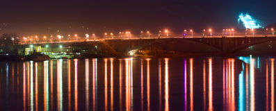 Night bridge. And reflections in water Royalty Free Stock Photo