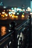 Night bridge fence. With blurred city background Stock Photos