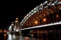 Night bridge Peter the Great. Illuminated bridge, black sky and lights reflections Stock Images