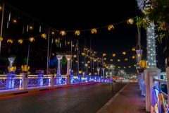 Night bridge in Siem Reap nicely decorated for Christmas royalty free stock photo