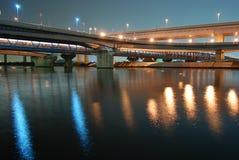 Night bridges. Night intersection  of highway bridges over reflection in big river water, Tokyo Japan Stock Image