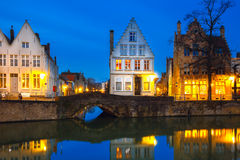Night Bruges canal with beautiful colored houses Royalty Free Stock Photo