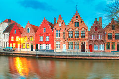 Night Bruges canal with beautiful colored houses Stock Photography