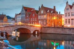 Night Bruges canal and bridge, Belgium Stock Photos