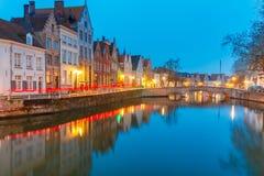 Night Bruges canal and bridge, Belgium Royalty Free Stock Photo