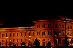 Night Budapest, glowing in gold. historic building is illuminated by light bulbs.  stock images