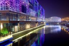Night building near river. With colorful lights,and lights bridge in front Royalty Free Stock Photos