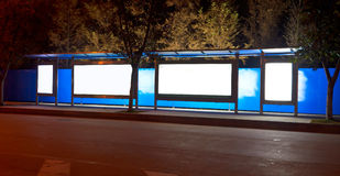 Night bus station. With blank billboard Stock Photos