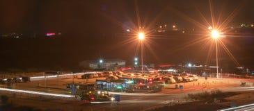 Night bus station. Zhuhai, China - November 16, 2012: Zuhai bei railway station temporary bus terminus at night Stock Images