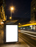 Night bus station with blank billboard. At night Royalty Free Stock Photos