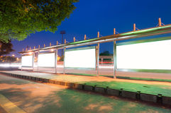 Night bus stop billboards Royalty Free Stock Images
