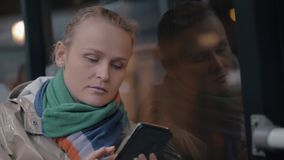 A night bus trip. A portrait of a young woman, interacting with her smartphone while travelling in a night bus stock video