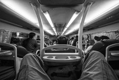 Night bus in Vietnam. Night bus in Vietnam, from Ho Chi Minh City to Chau Doc. Black and white image, people seen from their backs, no faces royalty free stock images