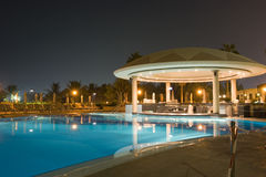 Night cafe by the pool Royalty Free Stock Photos