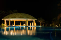 Night cafe by the pool Royalty Free Stock Photo