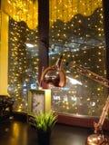 Night cafe window in illumination stock photography