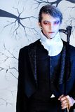 Night calmness. Portrait of a handsome young man with vampire style make-up. Shot in a studio Stock Image