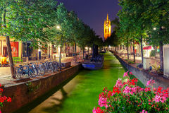 Night canal, Oude Kerk church, Delft, Netherlands Stock Photos