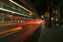 Night capture of the 5th Avenue. With cars driving by Royalty Free Stock Photos