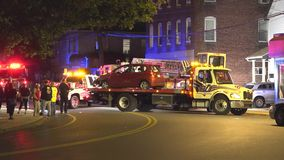 Night car accident removal, flatbed tow truck stock footage