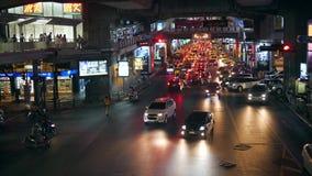 Night Car at Busy Traffic Road near Siam BTS Subway Train Station. 4K. Bangkok, Thailand - 15 NOV 2017. Night Car at Busy Traffic Road near Siam BTS Subway stock video