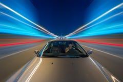 Night car and speedy blured neon lights stock image