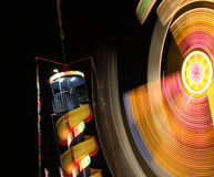 Night at the carnival. Rides, thrills, music  and motion at the local carnival at night royalty free stock photo