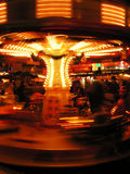 Night carousel. Lights of a carousel at the christmas fair by night Royalty Free Stock Photography