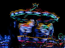 Night Carrousel. Merry-go-round twisting fast in the night with thousands lights Stock Image