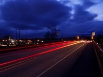 Night Cars. Car tail lights streaming through the twilight Royalty Free Stock Image