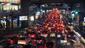 Night Cars Time Lapse at Busy Traffic Road near Siam BTS Subway Train Station. 4K. Bangkok, Thailand - 11 NOV 2017. Night Cars Time Lapse at Busy Traffic Road stock video