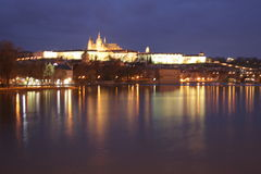 Night castle. Prague castle at night on the river banks in Prague royalty free stock images