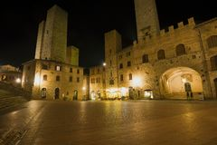 Night on the central square of medieval San Gimignano. Italy. Night on the central square of medieval San Gimignano. Tuscany, Italy royalty free stock photos