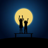 Night children. Children having a nocturnal party in the moonlight Royalty Free Stock Photo