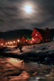The Night Before Christmas. Christmas night in a mountain village, situated on the banks of a small river. Full moon Royalty Free Stock Images