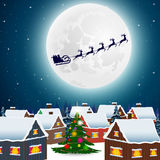 Night christmas forest landscape. Santa Claus flies reindeer  Stock Image