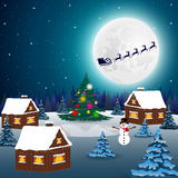 Night christmas forest landscape. Santa Claus flies reindeer  Stock Photo
