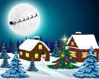 Night christmas forest landscape. Santa Claus flies reindeer in Stock Images