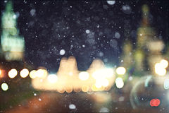 Night city ​​lights at horizon. Blurry night city ​​lights with snowfall Royalty Free Illustration