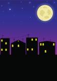 Night city. City under the night sky and the moon Royalty Free Stock Photo