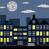Night city. Group of houses under night sky with moon Royalty Free Stock Image