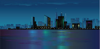 Night city. Over the ocean Stock Image