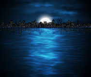 Night city. Night view of city on the coast with rising moon. Eps 10 Royalty Free Stock Photo