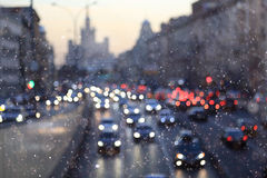 Night city background with blur cars. On road Royalty Free Stock Image