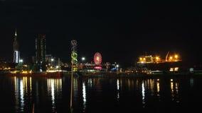 Night City Of Batumi, Georgia. Batumi Sea Port. Time Lapse. Night City Of Batumi, Georgia. Batumi Sea Port. Reflection evening Batumi city lights in the sea and stock video footage