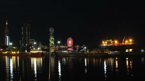 Night City Of Batumi, Georgia. Batumi Sea Port. Time Lapse. Night City Of Batumi, Georgia. Batumi Sea Port. Reflection evening Batumi city lights in the sea and stock footage